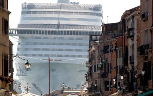 The MSC Divina cruise ship is seen in Venice lagoon June 16, 2012. Environmentalists urged film diva Sophia Loren to help stop a big cruise ship named in her honor from ever entering the Venice lagoon because of potential damage to the city and the lagoon's delicate ecosystem. The MSC Divina (Divine), which the actress christened last month in France, is a 139,500-tonne ship that can carry 3,500 passengers and nearly 1,000 crew. REUTERS/Stefano Rellandini (ITALY - Tags: TRAVEL ENVIRONMENT TRANSPORT)