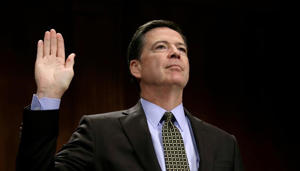 "FILE PHOTO: James Comey is sworn in to testify before a Senate Judiciary Committee hearing on ""Oversight of the Federal Bureau of Investigation"" on Capitol Hill in Washington, U.S., May 3, 2017."