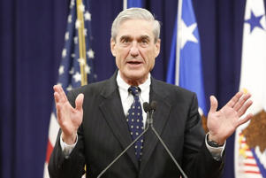 FILE PHOTO: Robert Mueller reacts to applause from the audience during his farewell ceremony at the Justice Department in Washington, August 1, 2013.