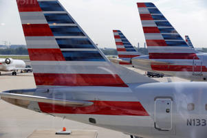 FILE PHOTO: American Airlines aircraft are parked at Ronald Reagan Washington National Airport in Washington, U.S., August 8, 2016.