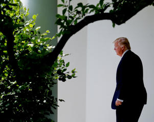President Donald Trump walks out of the Oval Office of the White House in Washington, Friday, May 19, 2017, to board Marine One for a short trip to Andrews Air Force Base, Md. Trump is leaving for his first foreign trip, visiting Saudi Arabia, Israel, Vatican, and a pair of summits in Brussels and Sicily.