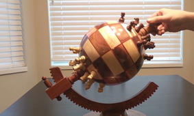 Father and son create beautiful globe-shaped chessboard