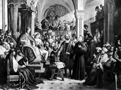 Slide 1 of 11: Martin Luther faces Emperor Karl V at the Diet of Worms, April 1521. Luther had been summoned there to recant his books, but refused to do so unless he could be convinced that he was wrong 'by scripture or by reason'. Luther was subsequently forced into hiding at Wartburg castle under the protection of the Elector of Saxony. After the Edict of Worms Martin Luther was condemned by the church as a heretic