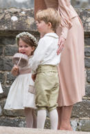 ENGLEFIELD GREEN, ENGLAND - MAY 20:  Princess Charlotte of Cambridge bridesmaid and Prince George of Cambridge attend the wedding Of Pippa Middleton and James Matthews at St Mark's Church on May 20, 2017 in Englefield Green, England.  (Photo by Samir Hus