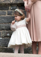 Catherine, Duchess of Cambridge holds the hand of flower girl Princess Charlotte following the wedding of Pippa Middleton and James Matthews at St Mark's Church, Englefield Green on May 20, 2017.