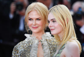 Australian actress Nicole Kidman (L) and US actress Elle Fanning pose as they le...