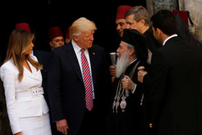 U.S. President Donald Trump (2nd L) and first lady Melania speak to Greek Orthodox Patriarch of Jerusalem Theophilos III (2nd R) are they stand at the entrance of the Church of the Holy Sepulchre in Jerusalem's Old City May 22, 2017.