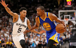 Golden State Warriors small forward Kevin Durant (35) drives to the basket while guarded by San Antonio Spurs point guard Dejounte Murray (5) during the second half in game three of the Western conference finals of the NBA Playoffs, May 20, 2017, at AT&T Center in San Antonio.