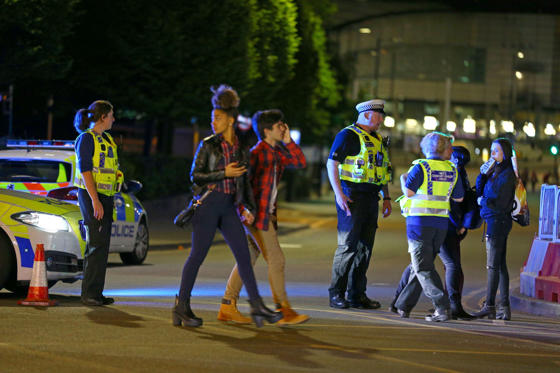Slide 27 of 27: Police and fans close to the Manchester Arena on May 23, 2017 in Manchester, England. There have been reports of explosions at Manchester Arena where Ariana Grande had performed this evening. Greater Manchester Police have have confirmed there are fatalities and warned people to stay away from the area.