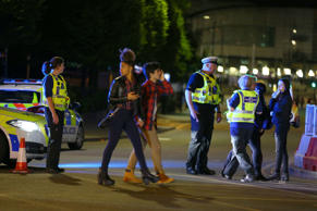 Police and fans close to the Manchester Arena on May 23, 2017 in Manchester, England. There have been reports of explosions at Manchester Arena where Ariana Grande had performed this evening. Greater Manchester Police have have confirmed there are fatalities and warned people to stay away from the area.