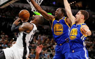 San Antonio Spurs shooting guard Jonathon Simmons (17) shoots the ball as Golden State Warriors power forward Draymond Green (23) and Klay Thompson (11) defend during the first half in game four of the Western conference finals of the NBA Playoffs on May 22, 2017, at AT&T Center in San Antonio.