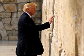 U.S. President Donald Trump prepares to leave a note at the Western Wall in Jerusalem May 22, 2017. REUTERS/Jonathan Ernst