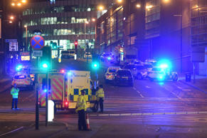 Emergency response vehicles are parked at the scene of a suspected terrorist attack during a pop concert by US star Ariana Grande in Manchester, northwest England on May 23, 2017.