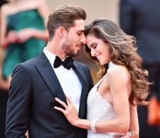 CANNES, FRANCE - MAY 22: Paris Saint Germain's goalkeeper Kevin Trapp (L) and Brazilian model Izabel Goulart (R) arrive for the premiere of the film 'The Killing of a Sacred Deer' in competition at the 70th annual Cannes Film Festival in Cannes, France on May 22, 2017. (Photo by Mustafa Yalcin/Anadolu Agency/Getty Images)