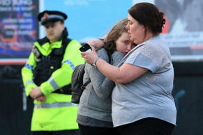 Walking casualties Vikki Baker and her thirteen year old daughter Charlotte hug outside the Manchester Arena stadium in Manchester, United Kingdom on May 23, 2017.