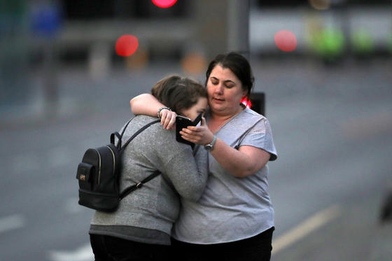 Slide 1 of 27: Ariana Grande concert attendees Vikki Baker and her daughter Charlotte, aged 13, leave the Park Inn where they were given refuge after last night's explosion at Manchester Arena on May 23, 2017 in Manchester, England.