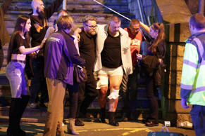 Police and other emergency services aid the injured near the Manchester Arena af...