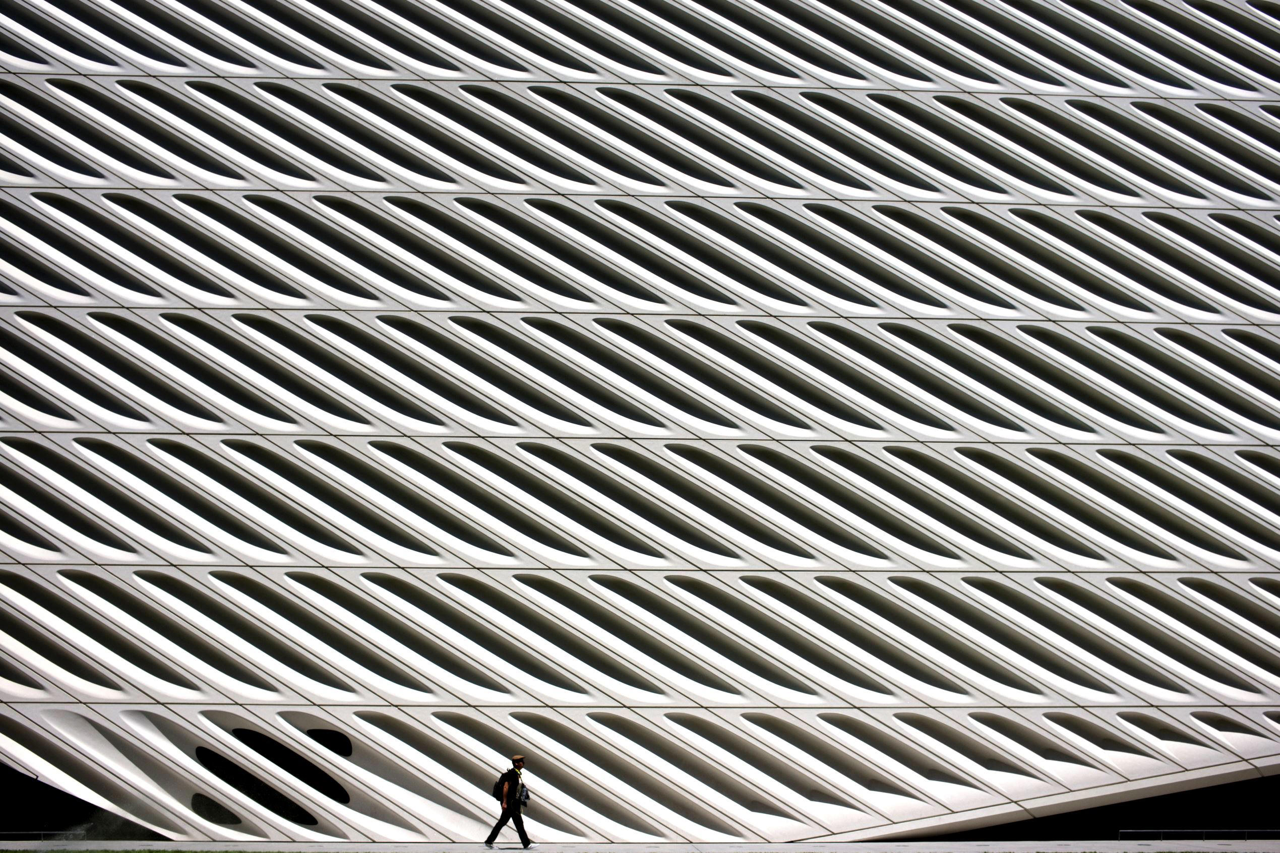 Slide 1 of 105: A man is dwarfed as he walks past The Broad museum on Monday, May 22, 2017, in downtown Los Angeles. The contemporary art museum was founded by philanthropist Eli Broad in 2015. (AP Photo/Jae C. Hong)