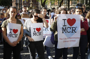 People gather ahead of a vigil in Albert Square, Manchester, after a 23-year-old man was arrested in connection with the Manchester concert bomb attack.
