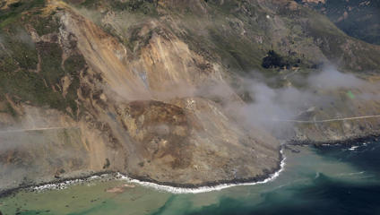 In this aerial photo taken Monday, May 22, 2017 provided by John Madonna showing a massive landslide along California's coastal Highway 1 that has buried the road under a 40-foot layer of rock and dirt. A swath of the hillside gave way in an area called Mud Creek on Saturday, May 20, covering about one-third of a mile, half a kilometer, of road and changing the Big Sur coastline.