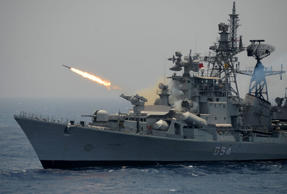 A rocket is fired from the Indian Navy destroyer ship INS Ranvir during an exercise drill in the Bay Of Bengal off the coast of Chennai on April 18, 2017.