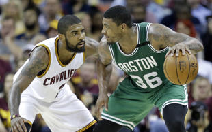 Boston Celtics' Marcus Smart (36) looks to drive on Cleveland Cavaliers' Kyrie Irving (2) during the second half of Game 3 of the NBA basketball Eastern Conference finals, Sunday, May 21, 2017, in Cleveland.
