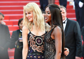 British model Naomi Campbell (R) and Australian actress Nicole Kidman pose as th...