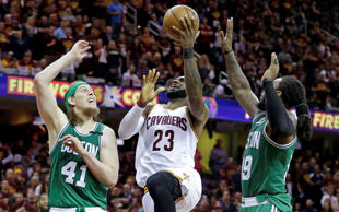 Cleveland Cavaliers' LeBron James (23) goes up for a shot between Boston Celtics' Kelly Olynyk (41) and Jae Crowder during the second half of Game 4 of the NBA basketball Eastern Conference finals, Tuesday, May 23, 2017, in Cleveland.