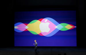(File Photo) Apple CEO Tim Cook waves as he arrive on stage during an Apple Special Event on at Bill Graham Civic Auditorium September 9, 2015 in San Francisco, California.