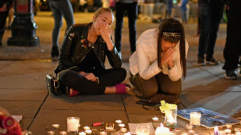 Members of the public attend a vigil in honour of the victims of Monday evening's terror attack in Manchester.