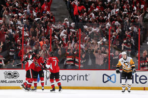 Bobby Ryan (9) of the Senators celebrates with teammates Mike Hoffman (68) and Kyle Turris (7) after scoring a goal against the Penguins on May 23 in Ottawa, Canada. The Senators won 2-1.