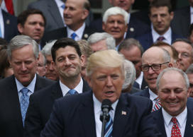 House Speaker Paul Ryan (R-WI) (2nd-L) listens as U.S. President Donald Trump co...