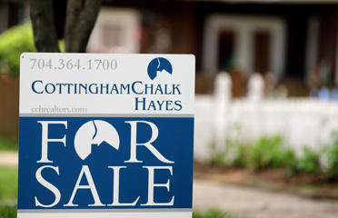 "In this Thursday, April 27, 2017, photo, a ""For Sale"" sign is posted in front of a home in Charlotte, N.C. On Wednesday, May 24, 2017, the National Association of Realtors reports on sales of existing homes in April. (AP Photo/Chuck Burton)"