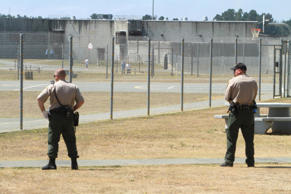 In this Aug. 17, 2011 file photo, correctional officers keep watch on inmates in the recreation yard at Pelican Bay State Prison near Crescent City, Calif.