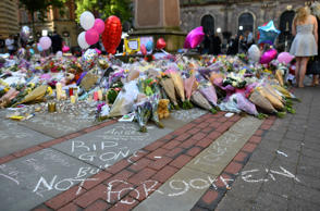 Flowers, messages and candles are pictured in St Ann's Square in Manchester, northwest England on May 25, 2017, placed in tribute to the victims of the May 22 terror attack at the Manchester Arena.
