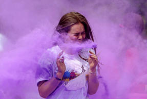 A participant runs through coloured powder as she takes part in the Get Rainbowed run in Prague, Czech Republic May 20, 2017. REUTERS/David W Cerny TPX IMAGES OF THE