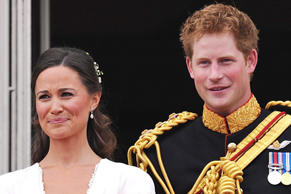 Prince Harry and Pippa Middleton stand on the balcony of Buckingham Palace following the wedding Prince William and Catherine Middleton on April 29, 2011.