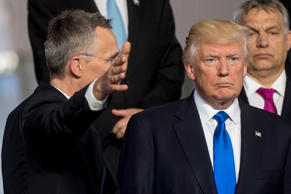 Secretary General Jens Stoltenberg gestures next to US President Donald Trump and Prime Minister of of Hungary Viktor Orban during a family picture during the NATO (North Atlantic Treaty Organization) summit at the NATO headquarters, in Brussels