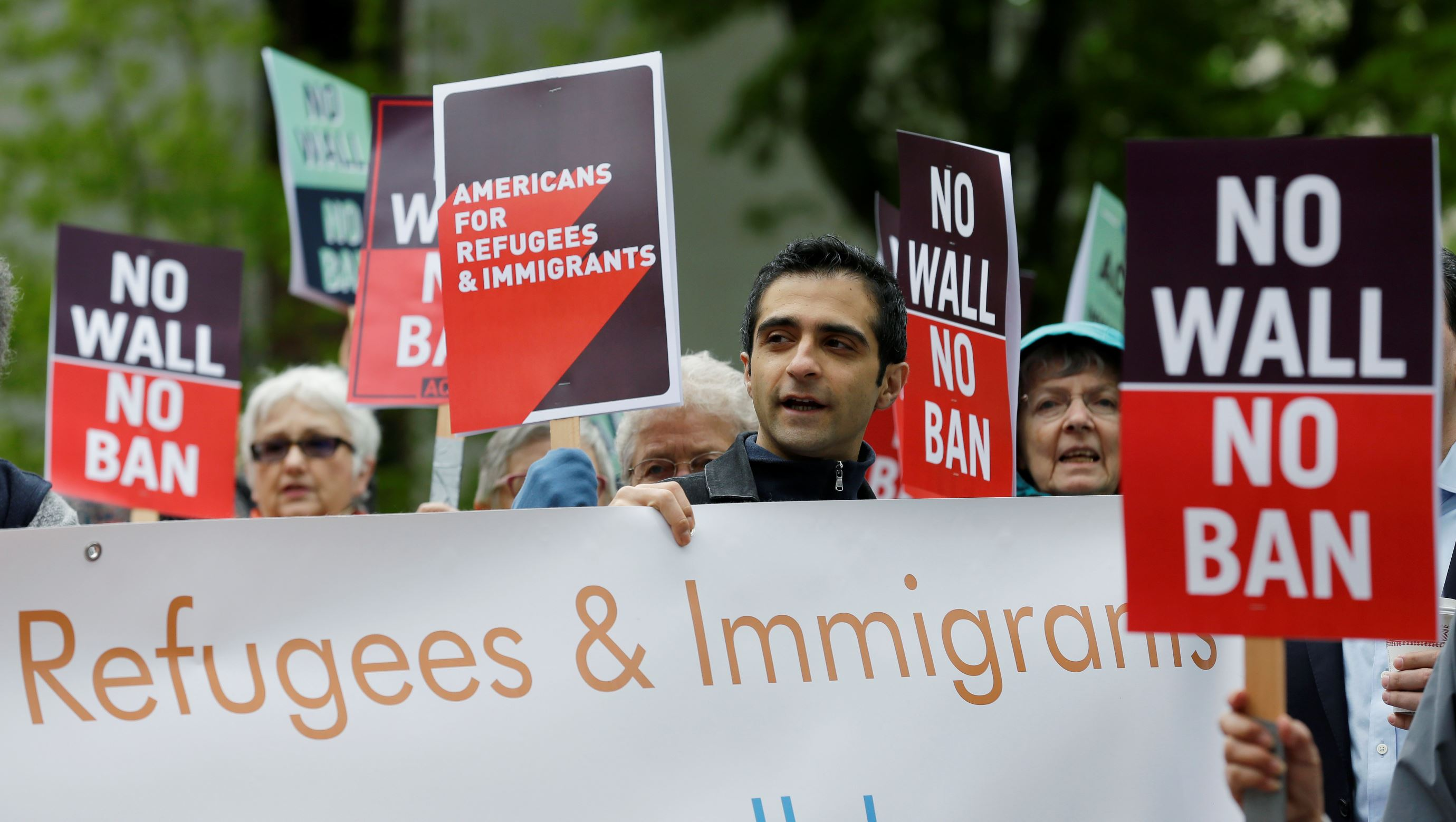 U.S. court lets Trump travel ban go partially into effect
