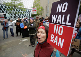 Irene Danysh of Burien, Washington protests outside as the 9th US Circuit Court of Appeals prepares to hear arguments on US President Donald Trump's revised travel ban in Seattle, Washington on May 15, 2017.