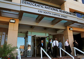 FILE - In this June 14, 2016 file photo, people stand outside the Democratic National Committee (DNC) headquarters in Washington.