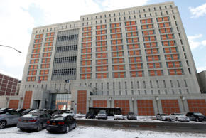 FILE- In the Jan 8, 2017 file photo, the Metropolitan Detention Center in the Brooklyn borough of New York is shown. Three male federal prison guards have been arrested on charges they sexually abused female prisoners at the facility.
