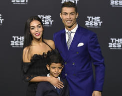 Real Madrid and Portugal's forward Cristiano Ronaldo poses with partner Georgina Rodriguez and his son Cristiano Ronaldo Jr