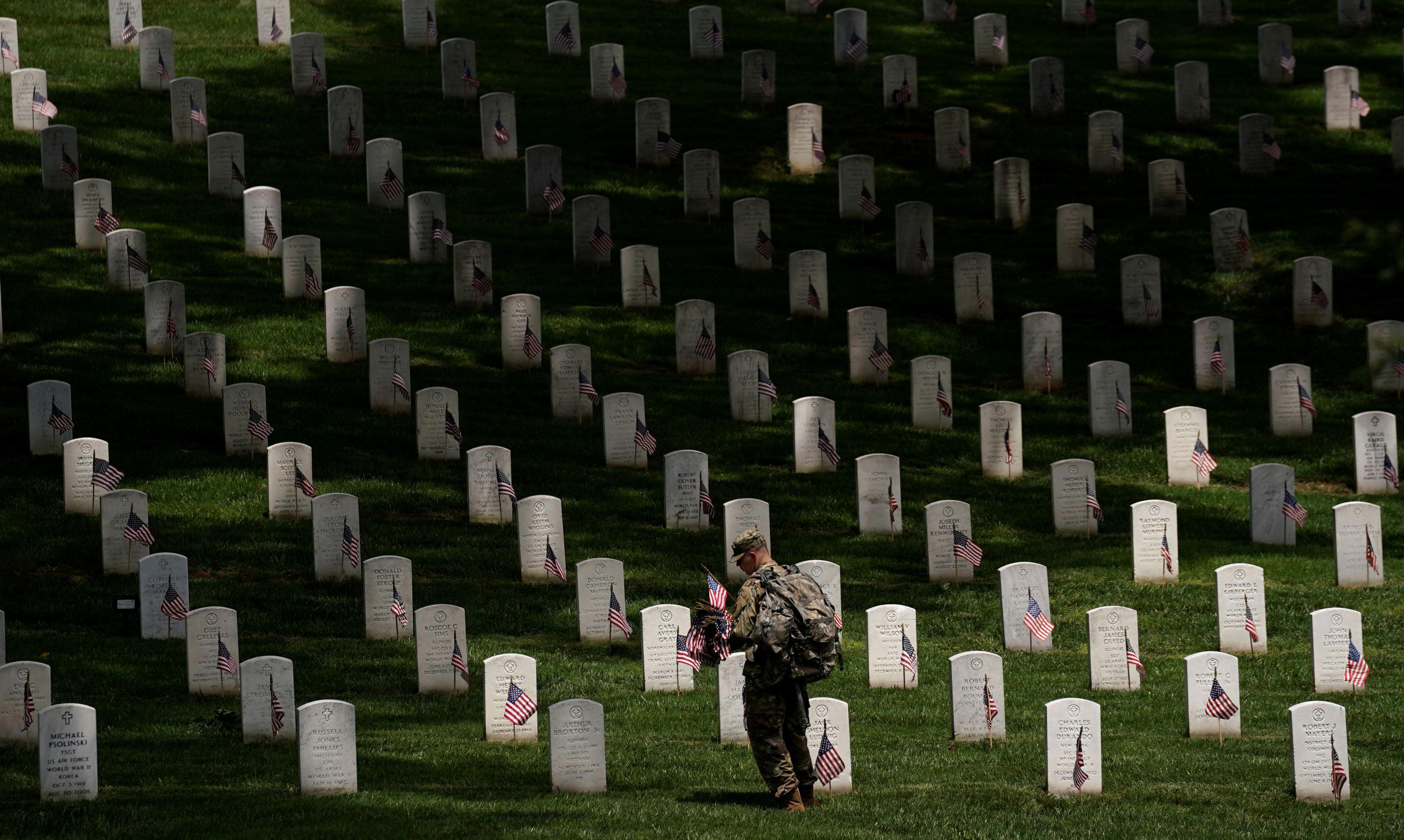 Slide 1 of 98: A soldier from the 3rd U.S. Infantry Regiment (Old Guard) takes part in