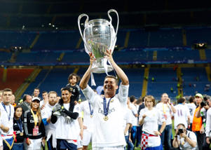 Real Madrid's Cristiano Ronaldo celebrates with the trophy after the Champions League final soccer match between Real Madrid and Atletico Madrid at the San Siro stadium in Milan, Italy, Saturday, May 28, 2016. Real Madrid won 5-4 on penalties after the match ended 1-1 after extra time.