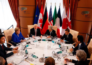 From left : Canadian Prime Minister Justin Trudeau, German Chancellor Angela Merkel, U.S. President Donald Trump, Italian Prime Minister Paolo Gentiloni, French President Emmanuel Macron, Japanese Prime Minister Shinzo Abe, Britains Prime Minister Theresa May, European Council President Donald Tusk and European Commission President Jean-Claude Juncker sit around a table during the G7 Summit of the Heads of State and of Government in Taormina, Sicily, on May 26, 2017.