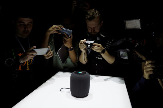 Slide 1 of 19: Members of the media photograph a prototype Apple HomePod during the annual Apple Worldwide Developer Conference (WWDC) in San Jose, California. Apple introduced the HomePod, a voice-controlled speaker that can make music suggestions and adjust home temperatures, taking aim at Amazon.com's Alexa feature and Echo devices.