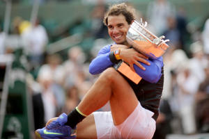 2017 French Open Tennis Tournament - Day Fifteen. Rafael Nadal of Spain with the trophy after his win against Stan Wawrinka of Switzerland in the Men's Singles Final match on Philippe-Chatrier Court at the 2017 French Open Tennis Tournament at Roland Gar