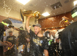 Stephen Curry #30 of the Golden State Warriors celebrates in the locker room after winning the NBA Championsip in Game Five of the 2017 NBA Finals against the Cleveland Cavaliers on June 12, 2017 at Oracle Arena in Oakland, California.