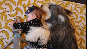 Dog spoons Kiwi baby during 'nap time'